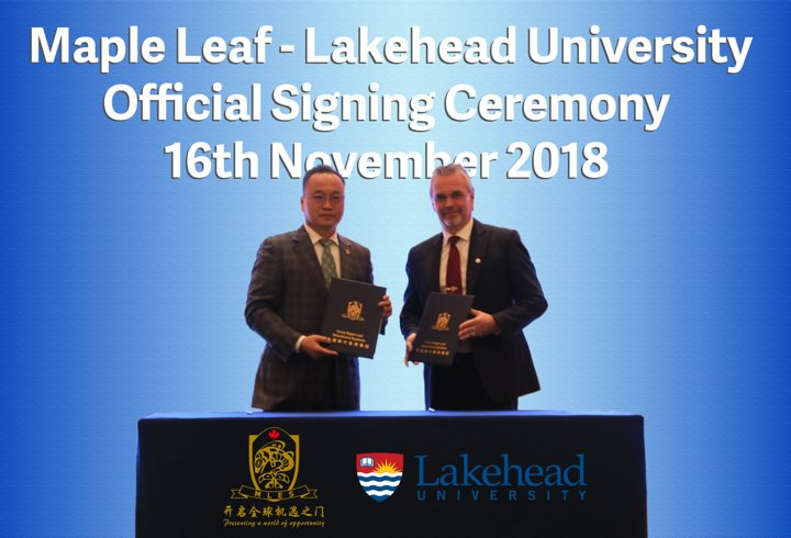 Dr. Sherman Jen, CMLES Chairman and Dr. David Barnett, Lakehead University, Provost at signing ceremony in Dalian, China.jpg